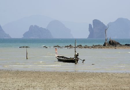 Longtail boat landing in Koh Yao Noi island in Thailand Stock Photo - 2249540