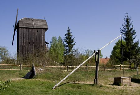 wooden windmill and well-draw in poland Stock Photo - 3170009