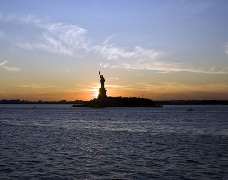 Statue of Liberty by Sunset, New York City. photo
