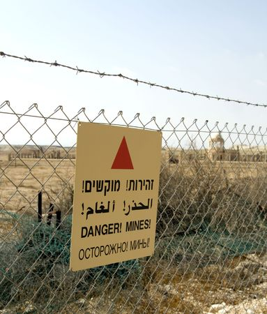 minefield sign in Hebrew, Arabic, English and Russian in Jordan valley, Israel Stock Photo - 4611225