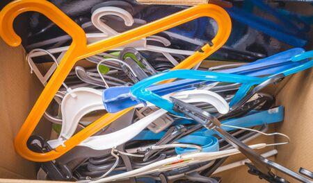 pile of assorted coat hangers