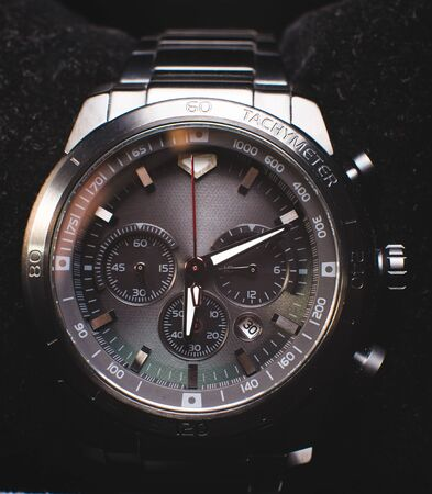 Precious chronograph watch in stainless steel in black circular gradient background - Logos, brand, or anything has been deleted to be hundred percent commercial.