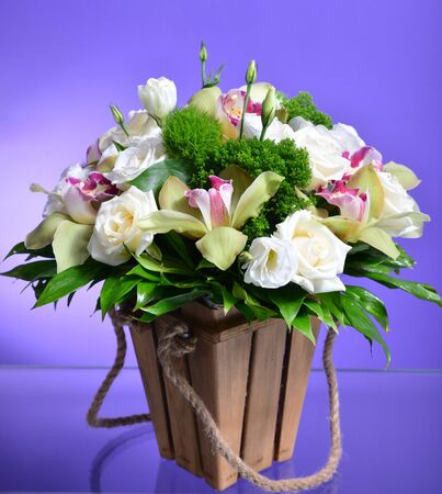 Close up flower bouquet arrangement in wicker basket isolated on white, carnation, rose, orchid, anunculus Stok Fotoğraf