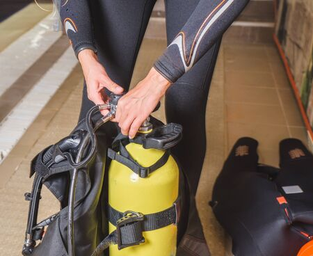 Diver prepares his equipment for diving in the sea. Stok Fotoğraf