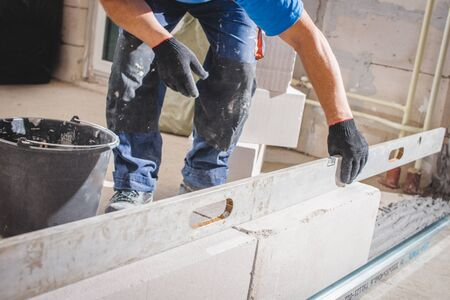 Mason plastering the concrete to build wall, Construction under building with mason plastering concrete to brick wall Stok Fotoğraf