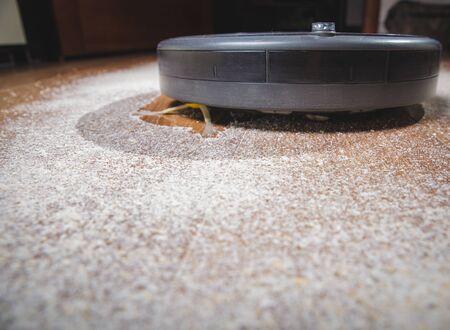 Robotic vacuum cleaner on carpet - technology housework Stok Fotoğraf