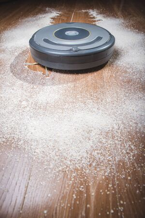 Robot vacuum cleaner cleans a dirty floor.