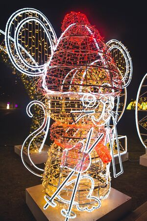 Moscow, Russia - December 28, 2019: Holiday New Year decorations of the capital of Russia. A Christmas glowing sculpture in the shape Mouse. Installation art `Journey to Christmas`