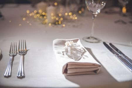 A photo of place settings laid out on a restaurant table