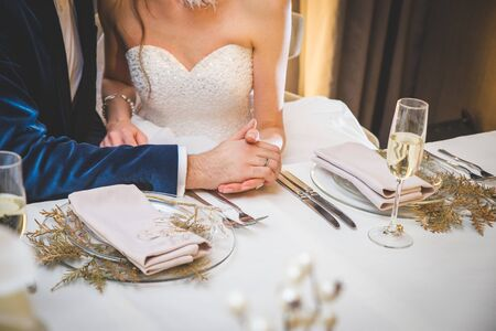 Wedding flowers on a table (bride and groom in a background) Stok Fotoğraf