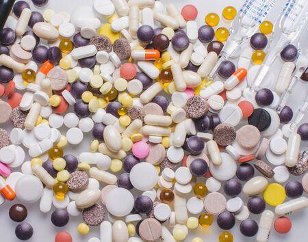 White pills, white background