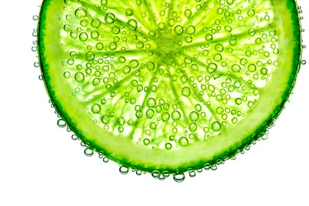 Lime with bubbles in water isolated on white background Reklamní fotografie