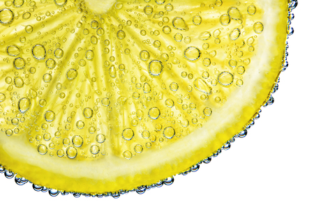 lemon with bubbles in water isolated on white background