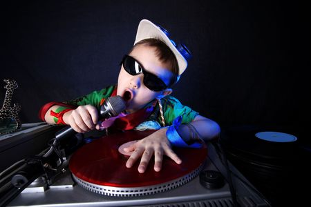 children party: cool kid DJ in action