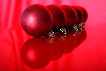 isolataion: red christmas balls with reflections isolated on red Stock Photo