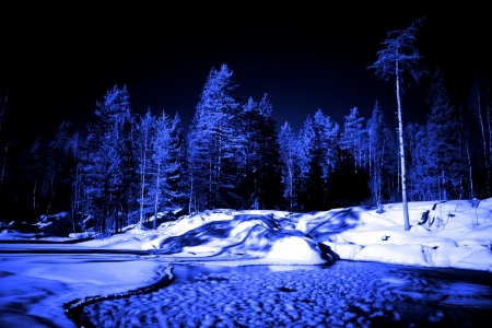 moon night in winter forest and lake with ice ball photo