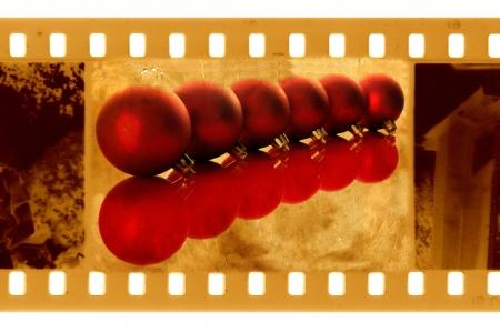 christmas movies: old 35mm frame photo with christmas balls Stock Photo