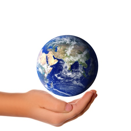 Save the world - hands around earth .  photo