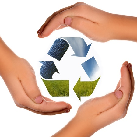 Three arrows of nature elements, recycling symbol with hands photo