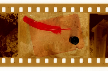 oldies: oldies 35mm frame photo with vintage inkwell and feather Stock Photo
