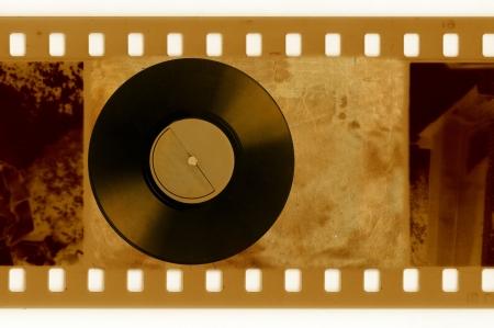 oldies: oldies 35mm frame photo with vintage vinyl disk