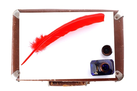 Antique red pen witn inkwell and suitcase isolated on white photo