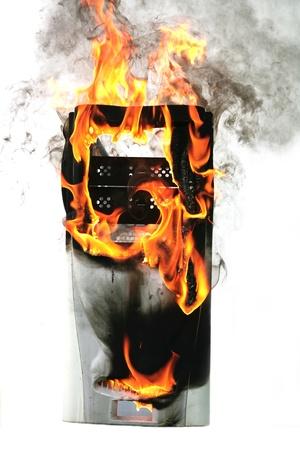 ignite: burninging computer case Stock Photo