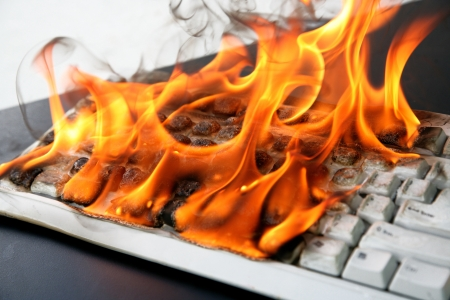 fire protection: burning computer keyboard Stock Photo