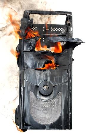 burning computer case isolated on white photo
