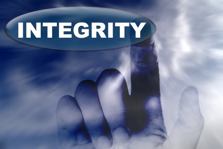 hand and button with word of INTEGRITY photo