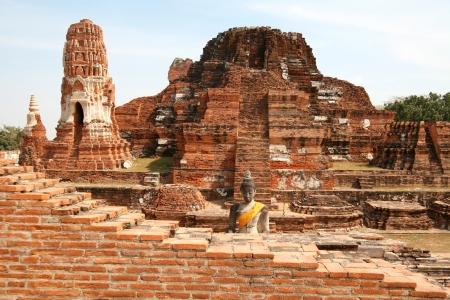 Ruins the temple of Wat Mahatat and Buddha in Ayutthaya near Bangkok, Thailand photo