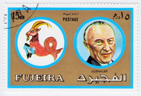 FUJEIRA - CIRCA 1971 : stamp printed in Fujeira, Zodiac Signs of Famous People  shows image of the German statesman Konrad Hermann Joseph Adenauer and Capricorn the sea goat, circa 1971  Stock Photo - 15767634