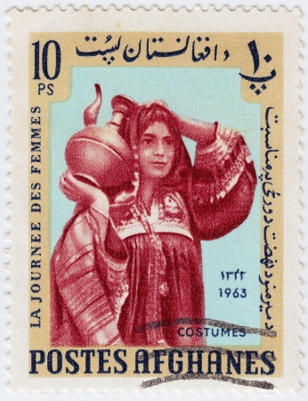 AFGHANISTAN - CIRCA 1963 : stamp printed in Afghanistan showing afghan woman in native costumes, circa 1963 Stock Photo - 15767631