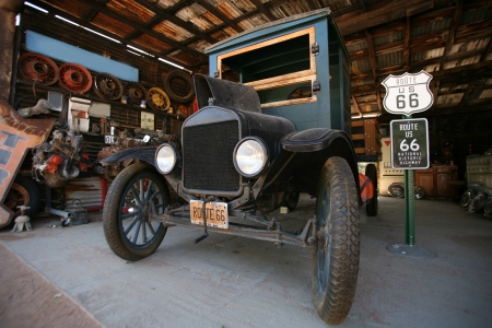 rout: vintage car FORD beside historical route 66 Editorial
