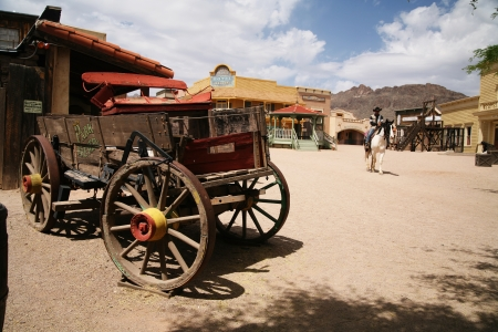 old wood farm wagon: Antique american cart in old western city