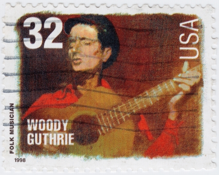 woody: USA - CIRCA 1998   stamp printed in USA show American folk Musician Woody Guthrie, circa 1998 Editorial