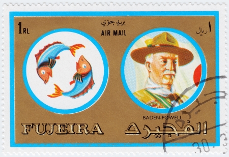 fujeira: FUJEIRA - CIRCA 1971 : stamp printed in Fujeira, Zodiac Signs of Famous People  shows Pisces the fish and Robert Baden-Powell, founder of the Scout Movement, circa 1971
