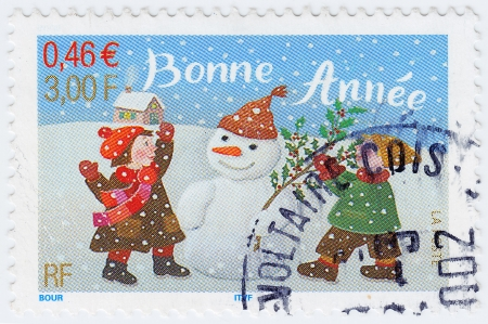 FRANCE - CIRCA 1996: stamp printed in France show Snow man and children, circa 1996