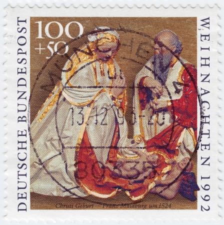 FERMANY - CIRCA 1992 : greeting Christmas stamp printed in Germany shows birth of Jesus Christ pic of Franz Maidburh, circa 1992