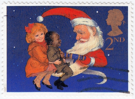 UNITED KINGDOM - CIRCA 1997  stamp printed in UK Christmas Postage Stamp showing Children and Santa pulling a Christmas Cracker, circa 1997  Stock Photo - 15792597