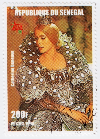 SENEGAL - CIRCA 1998 : Stamp printed in Senegal with popular 1960s actress Catherine Deneuve, circa 1998