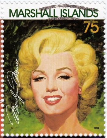 monroe: MARSHALL ISLANDS - CIRCA 1995  Stamp printed in Marshall Islands with popular 1960s American actress Marilyn Monroe, circa 1995