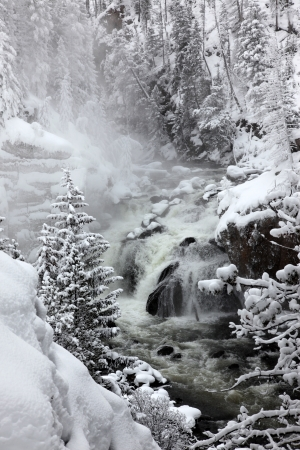 Falls in Yellowstone National Park in winter season, USA photo