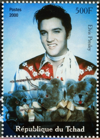 TCHAD - CIRCA 2000 : stamp printed in Tchad - famous actor and rock and roll singer Elvis Presley, circa 2000 Stock Photo - 15816420