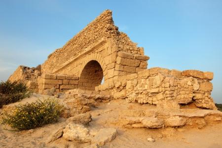 ceasarea: Classic Israel - Sundown at old Ancient Roman aqueduct in Ceasarea at the coast of the Mediterranean Sea