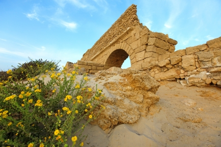 Ancient Roman aqueduct in Ceasarea at the coast of the Mediterranean Sea, Israel photo