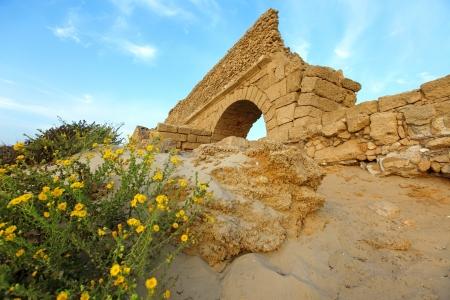 ceasarea: Ancient Roman aqueduct in Ceasarea at the coast of the Mediterranean Sea, Israel Stock Photo