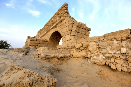 Ancient Roman aqueduct in Ceasarea at the coast of the Mediterranean Sea, Israel Stock Photo