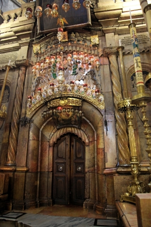 Classic Israel - Sepulchre of Jesus Christ in the church of the Holy Sepulchre in Jerusalem photo