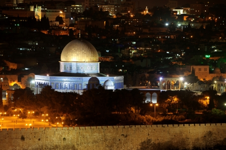 Night view of Temple Mount with Dome of the Rock and old city from the Mt of Olives in Jerusalem photo